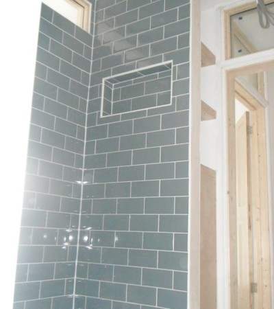 Shower cubicle and shelving cutout